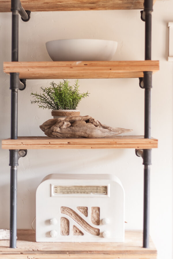 Combine different textures and heights to create beautifully designed decorative wall shelves.