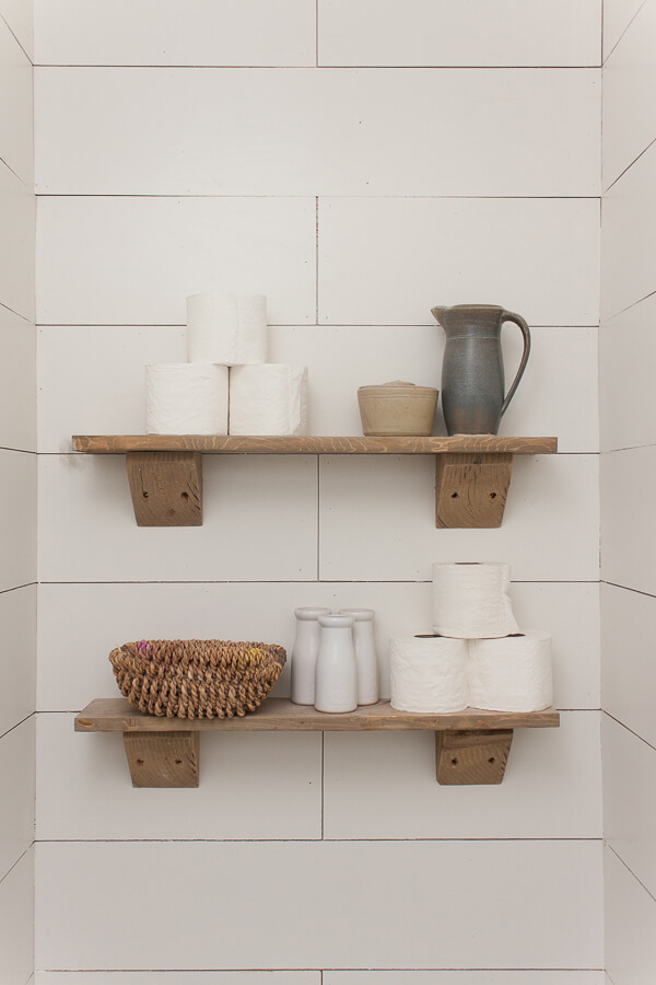 Love these rustic wood shelves in the water closet!
