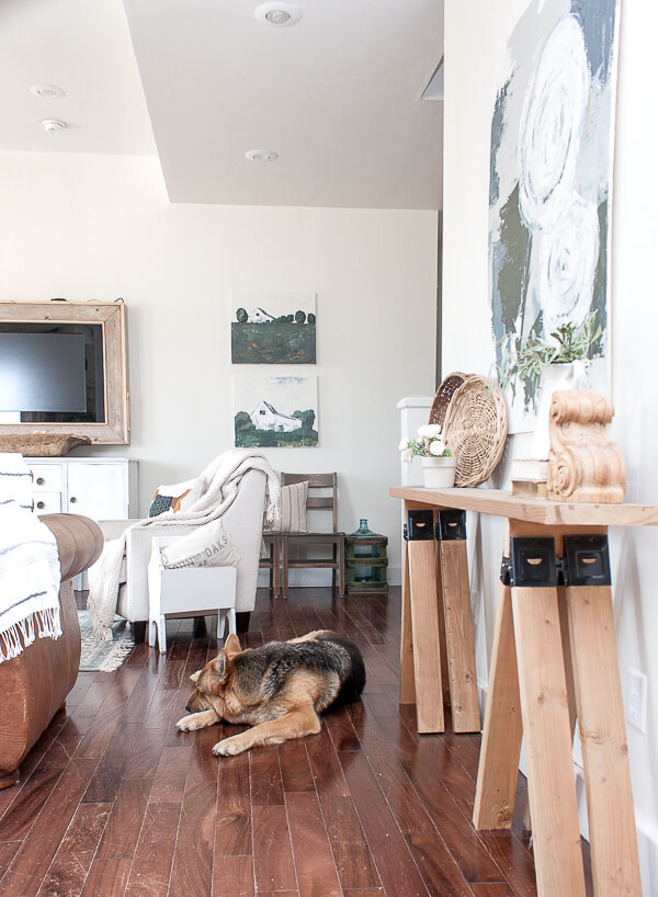 Beautiful space and that dog! Love the landscape art and calm feel to the space.