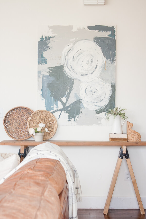 I love the combination of the farmhouse artwork, and the rustic wooden sawhorse table!  Full tutorial found here!