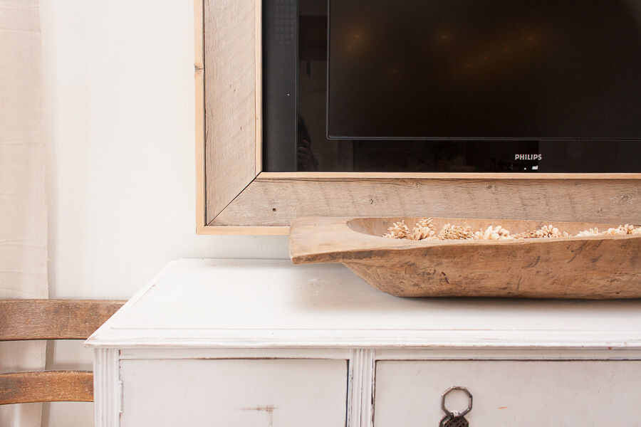 Make a DIY TV frame and conceal that ugly Television right now!