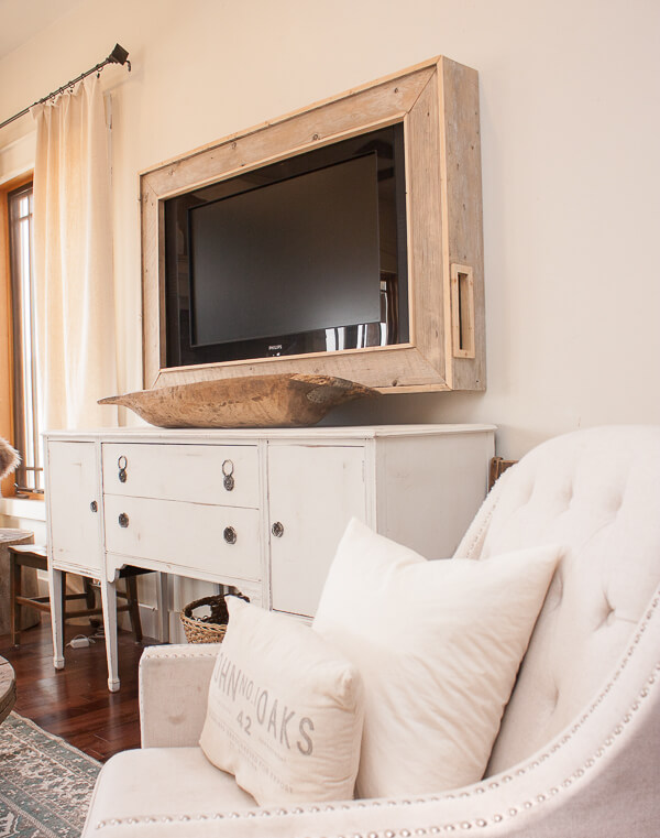 This DIY TV frame has transformed this whole room! No more ugly television and its now a focal point!