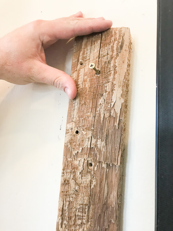 Use wood blacks to attach a TV frame to the wall
