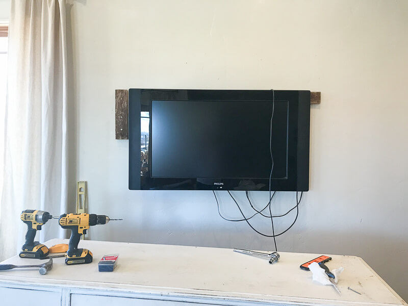 How cna you hide this ugly TV? With a rustic wood TV frame!