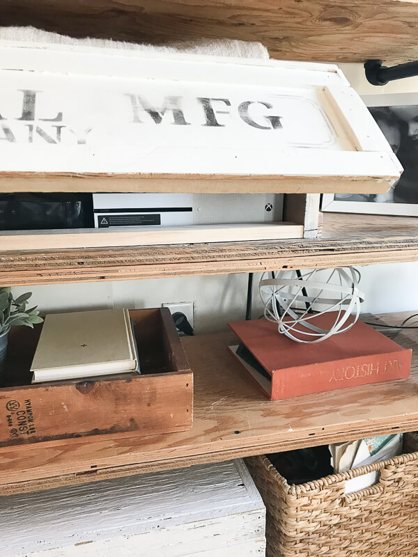 Using an old crate to hide ugly electronics is such a genius idea!