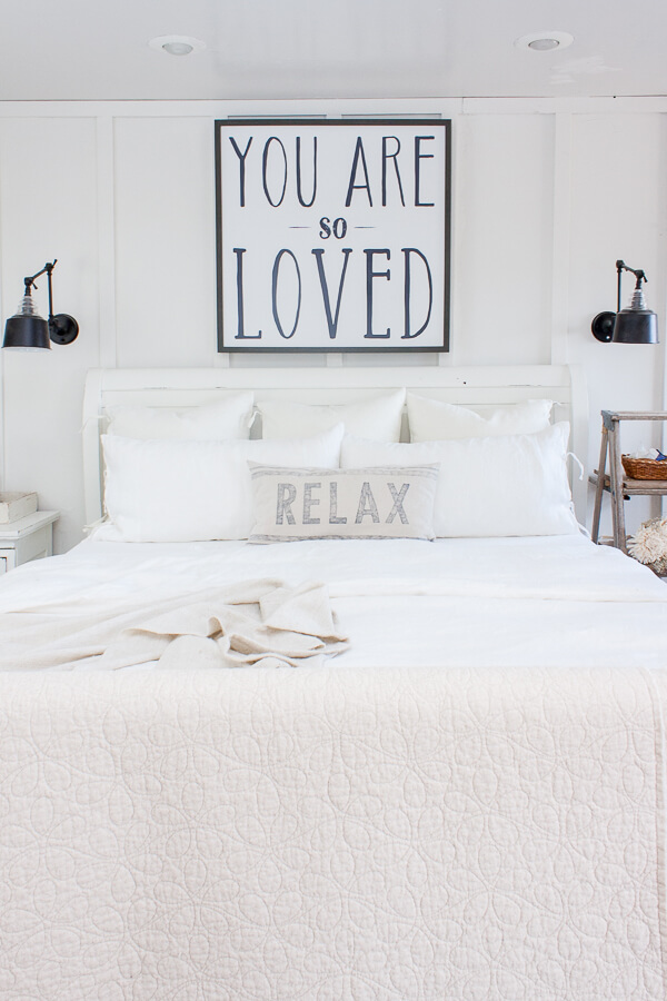 Cozy master bedroom with white linen bedding from IKEA and a simple solution to keeping bed pillows looking like new!