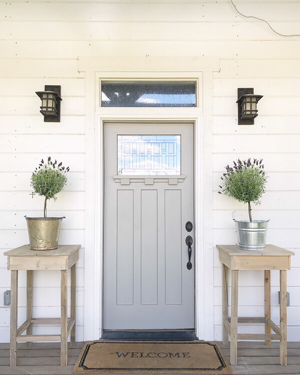 Create this farmhouse style outdoor side table with these easy to follow instructions! I cant believe it was made out of scrap wood!
