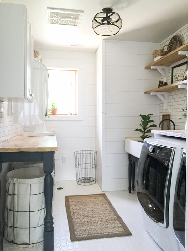 White mosaic farmhouse tiles, shiplap, and white subway tile finish off this farmhouse laundry room