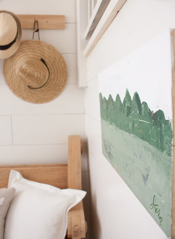 Small farmhouse artwork in the entryway. Vibrant greens and whites contrast each other beautifully