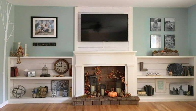 DIY faux fireplace ideas with bookshelves flanking the fireplace