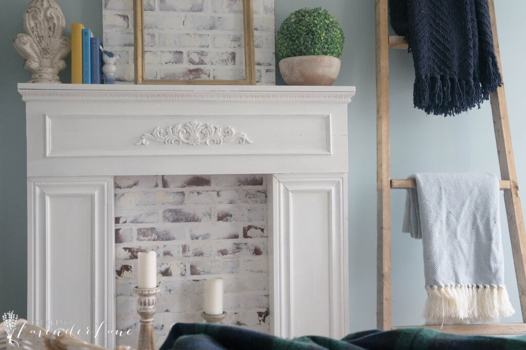Super sweet DIY faux fireplace with brick insert