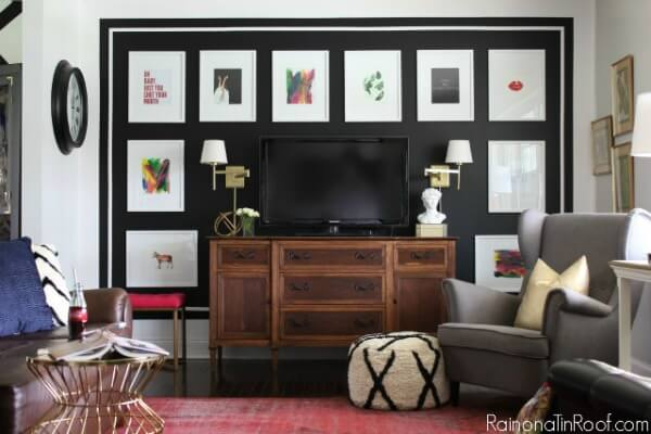 Decorate around a TV with a black accent wall!