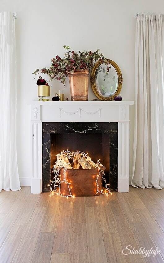 Stunning DIY faux fireplace ideas with real wood logs in the insert