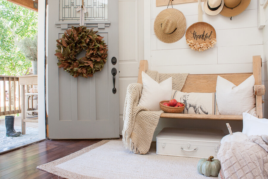 Cozy and serene fall decor in the entryway, full of farmhouse decor, raw wood, and so much more!