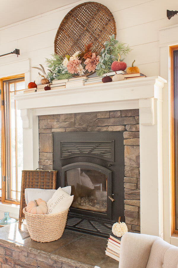 Fall mantel decor with flowers, pumpkins and books!