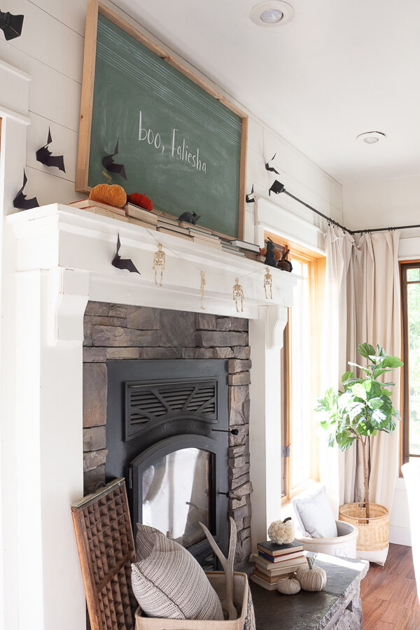 How to create a stylish and chic Halloween mantel. Love this vintage green chalkboard!