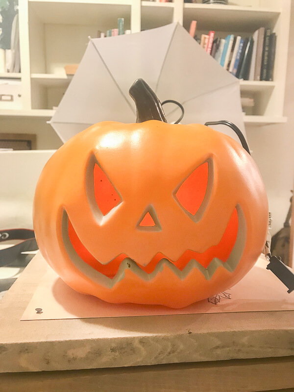 Paint plastic jack-o-lanterns for  updated Halloween decor