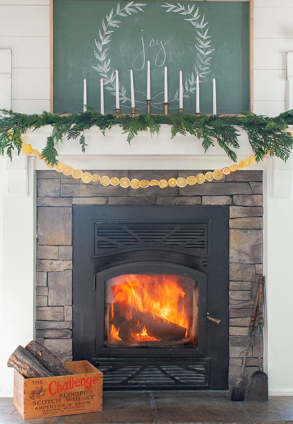 Scandinavian Christmas mantel with a farmhouse twist!
