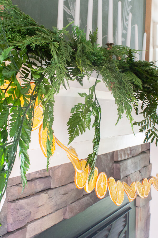 Dried orange garland and fresh greenery on the mantel for Christmas!
