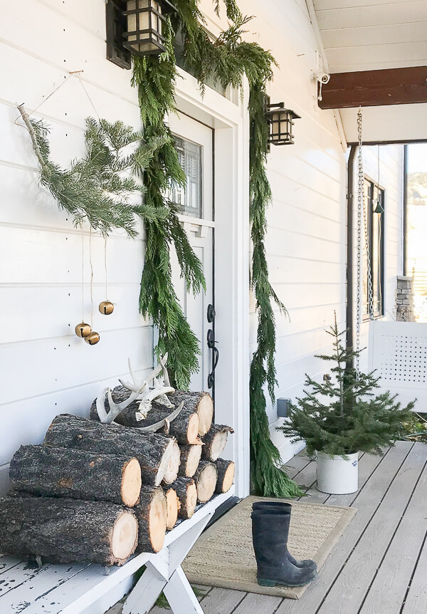 A touch or Nordic or Scandinavian Christmas decor on the porch