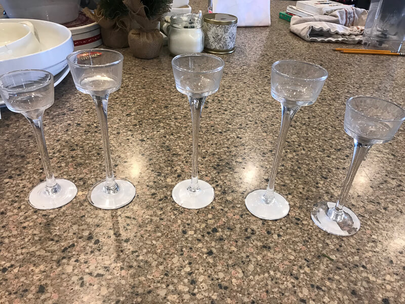 Transform these dollar store tea candle holders into Swedish candlestick holders in no time!