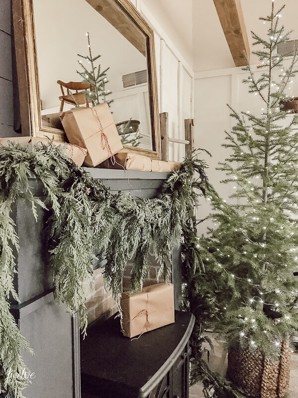 Fresh greenery, simple wrapped Christmas presents, and oodles of farmhouse Christmas bedroom decor.