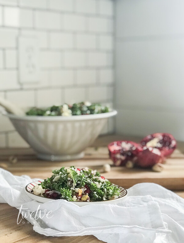 Make this unique kale, wild rice, feta cheese, and wild rice pomegranate salad today!