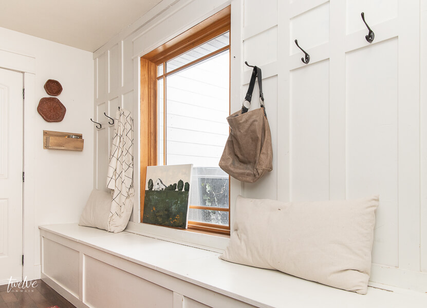 Clean and organized farmhouse style mudroom with gorgeous winter and spring decor accents.