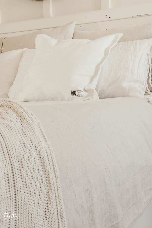 Get farmhouse bedding for practically nothing with this easy bedding hack!