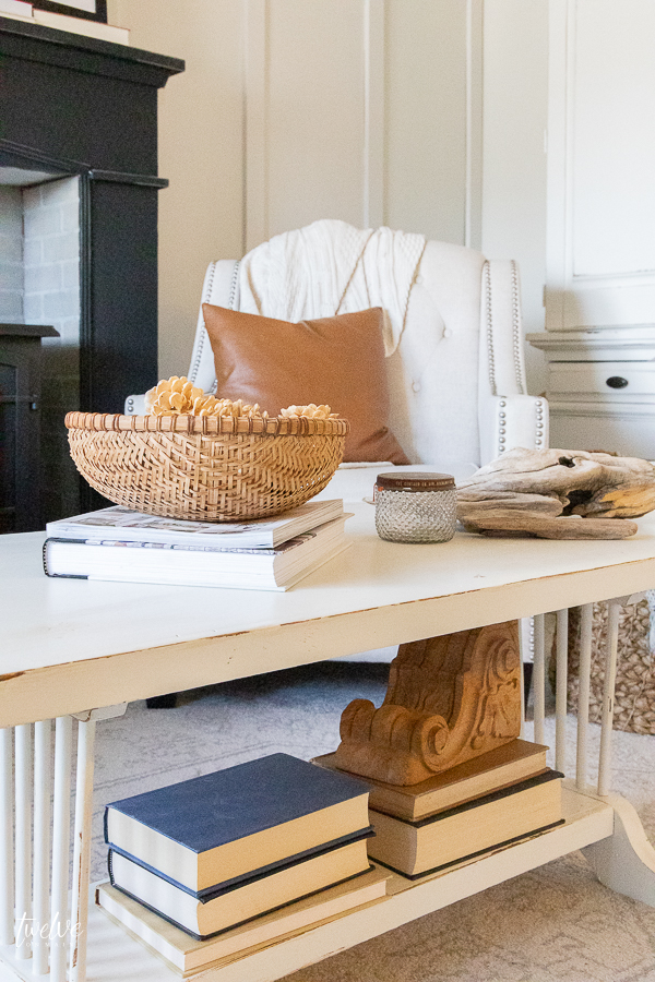Beautifully styled coffee table in this modern farmhouse bedroom. Try these tips to learn how to style a coffee table like a pro!