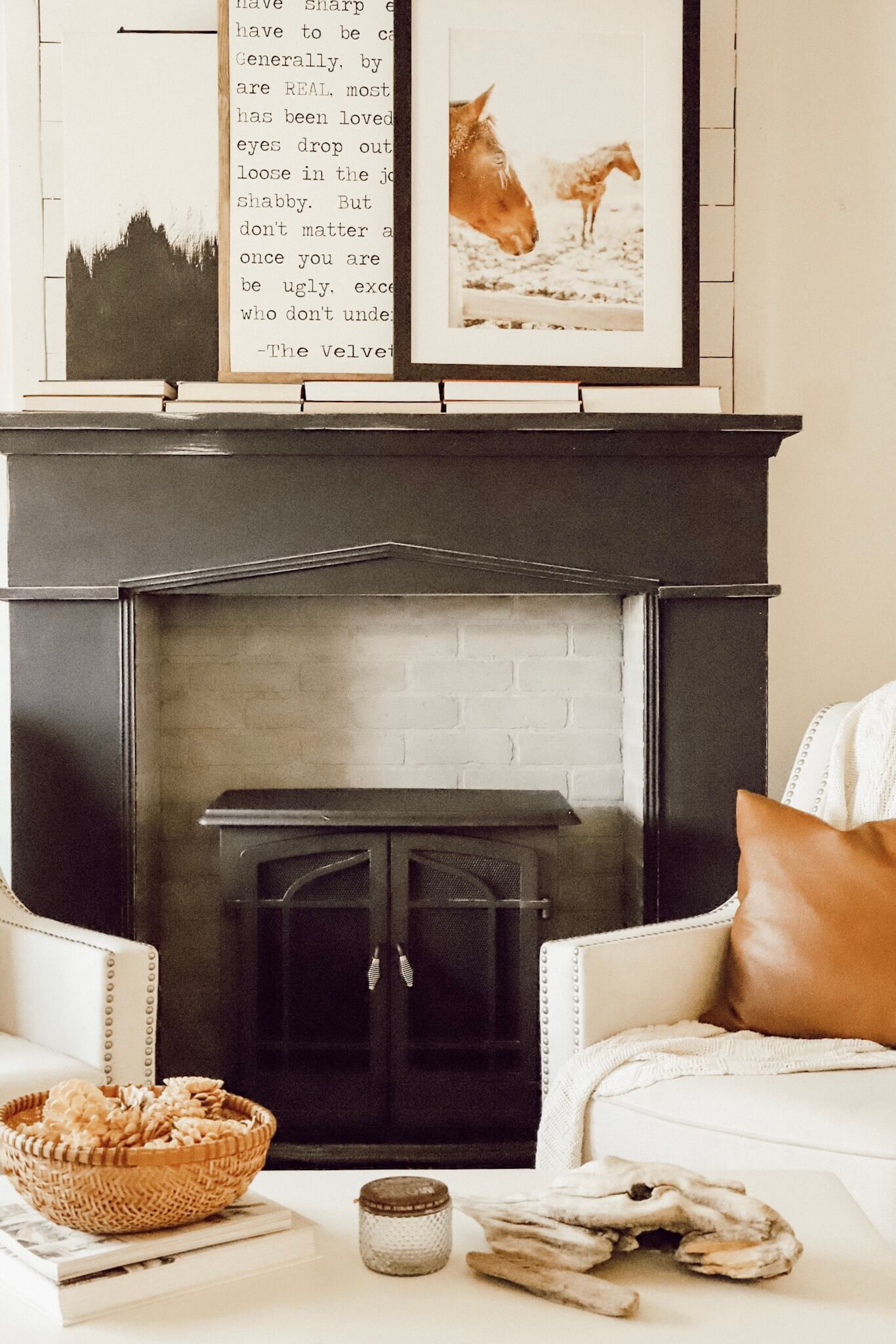 We updated out fireplace!  Introducing our new painted fireplace in black!  Such a showstopper!