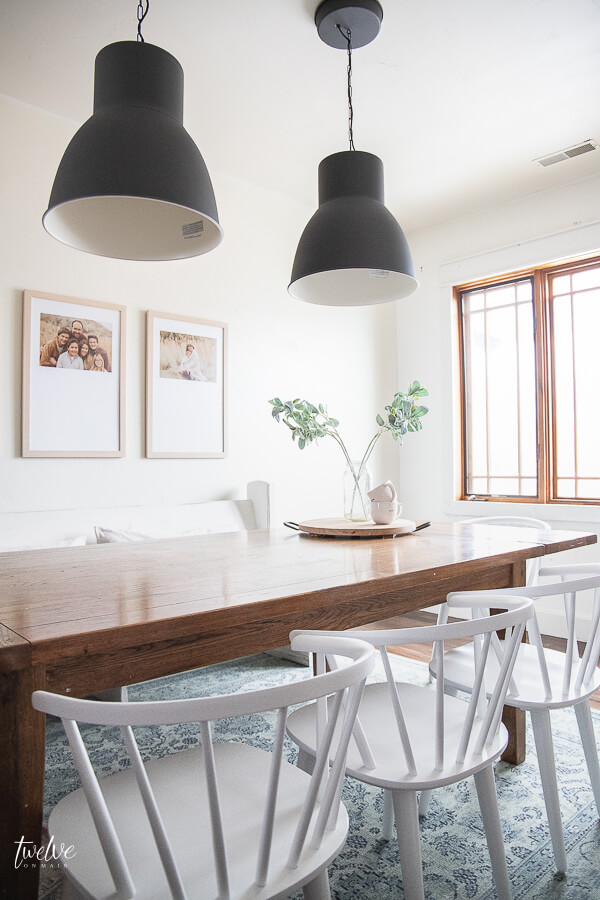 I am obsessed with these IKEA Hektar lights, and the custom framed artwork in this modern farmhouse dining room design!