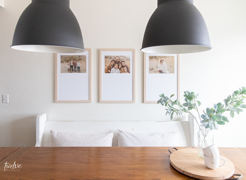 Modern farmhouse dining room design touches including custom framed artwork and modern IKEA Hektar lights!