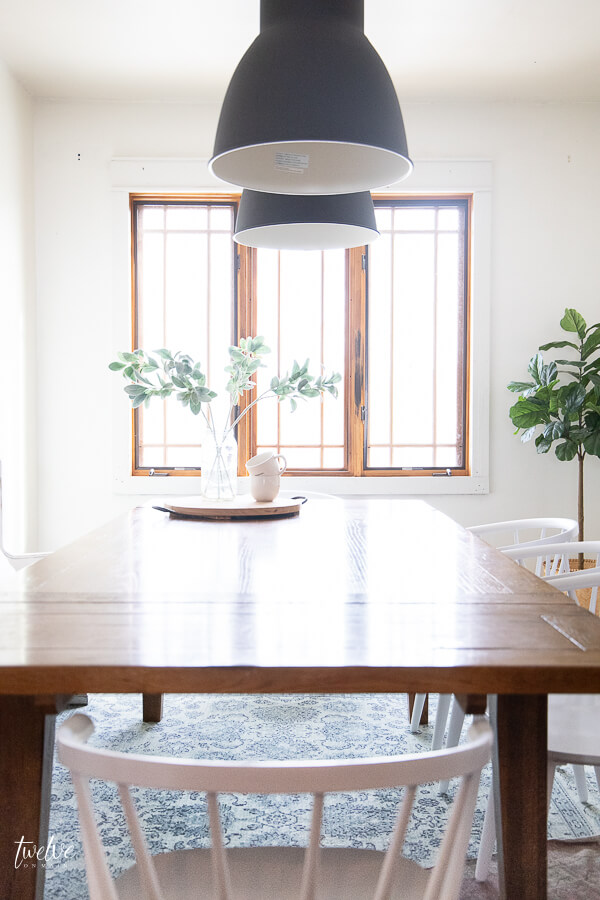 Wood windows are a huge feature in this modern farmhouse dining room!