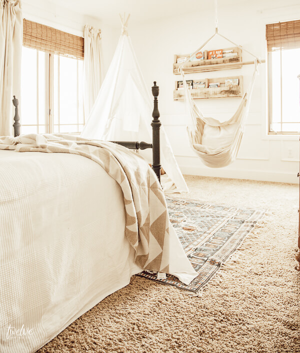 I cannot get enough of this little girls room! Love the cozy boho style reading nook!