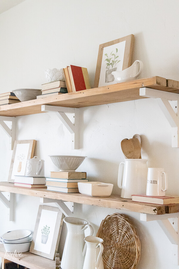 These watercolor plant printables add the perfect touch of spring to these rustic reclaimed wood shelves. So perfectly farmhousey