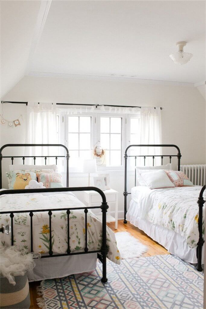 Girls bedroom with metal beds!  So cute!