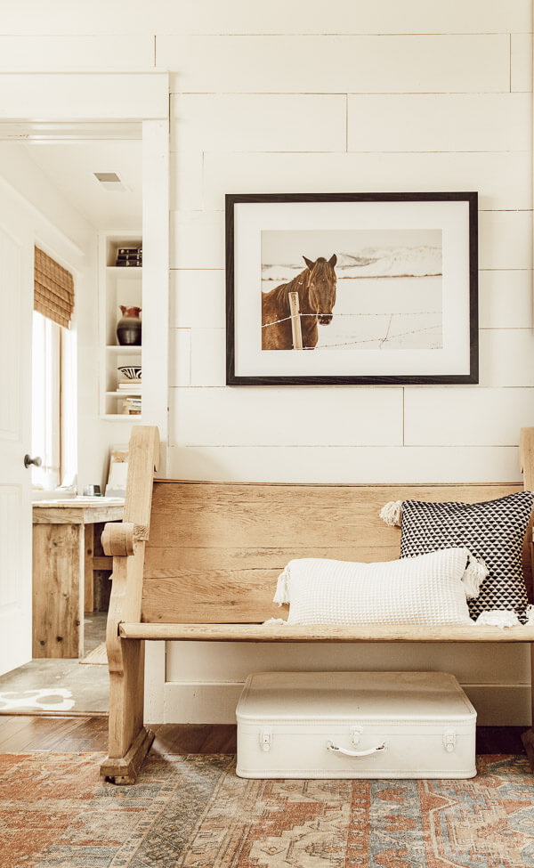 Gorgeous horse photography in this modern farmhouse entryway