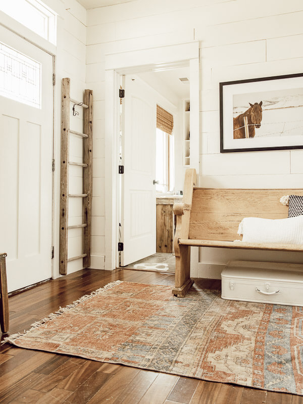 Simple farmhouse spring entryway, with minimal touches. I love this.