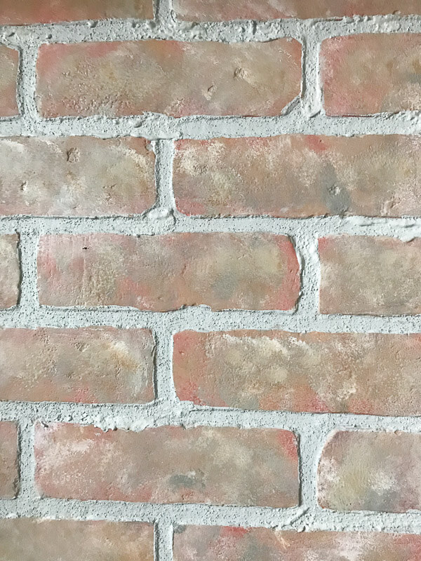 How to turn faux brick panels into stylish home decor that looks like its been there for years.