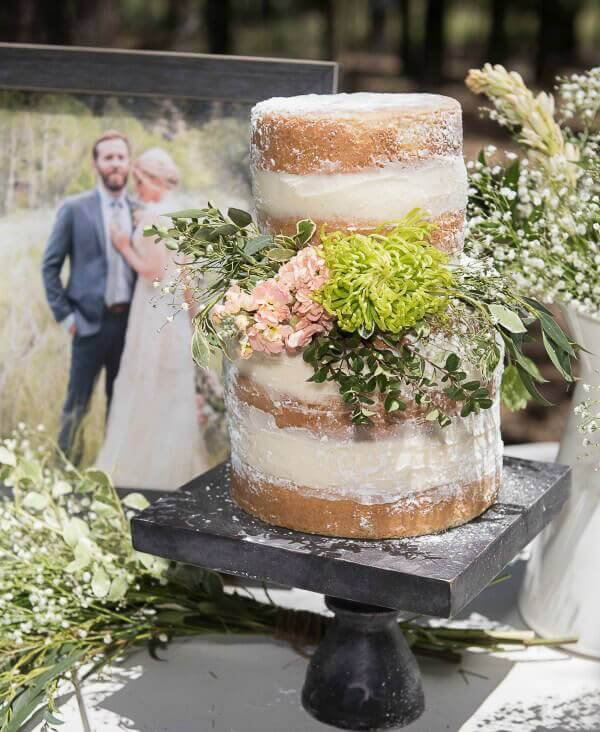 Outdoor naked wedding cake with flowers