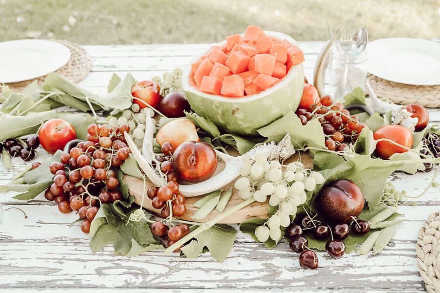 Enjoy your summer with a gorgeous and delicious edible summer tablescape.  Check out all these great ideas!