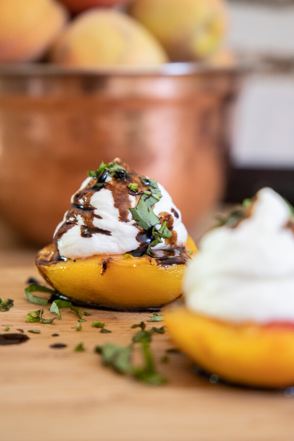 Try this delicious roasted peach dessert. With the combination of cheesecake mousse, basil and balsamic reduction this dessert screams eat me!