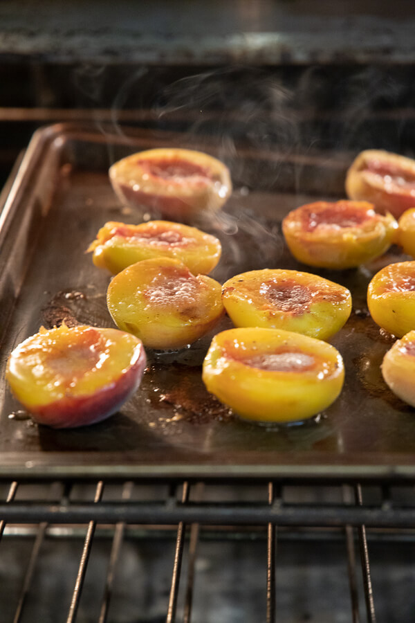 roasted peaches in the over for a decadent peach dessert