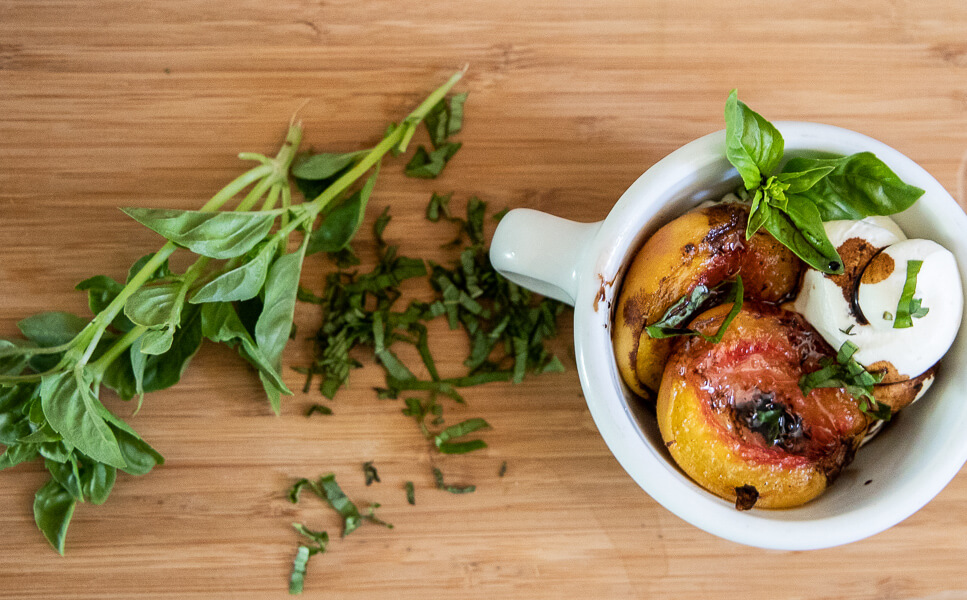 Try this decadent roasted peach dessert with homemade cheesecake mousse, basil, and a balsamic reduction. Its the perfect party treat or just for yourself on a Friday night!