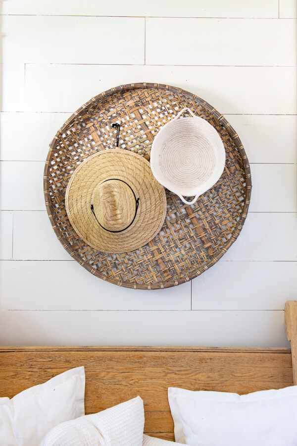 Large baskets hung on the wall as wall decor in the entryway