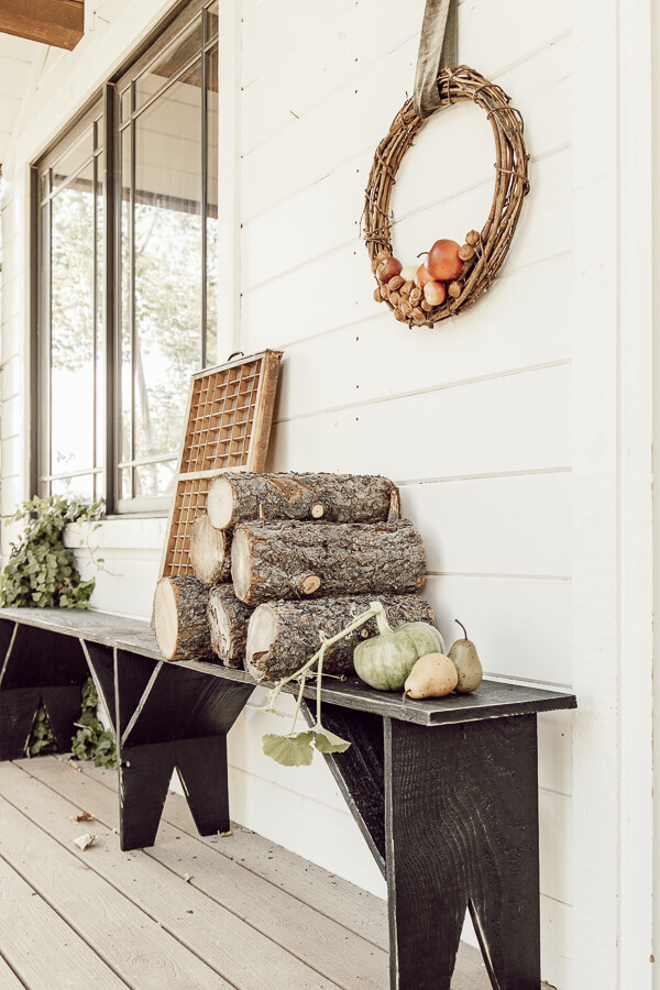 This hand built primitive style black bench is the focal point of my fall porch decor. It goes perfectly with my handmade apple and walnut wreaths!