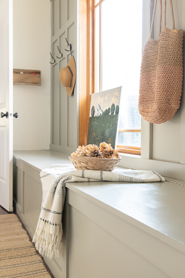 Mudroom decor ideas and mudroom design ideas that are easy and functional! Check out this mudroom bench with storage. It hides all out ugly stuff, allowing us to still enjoy the space.