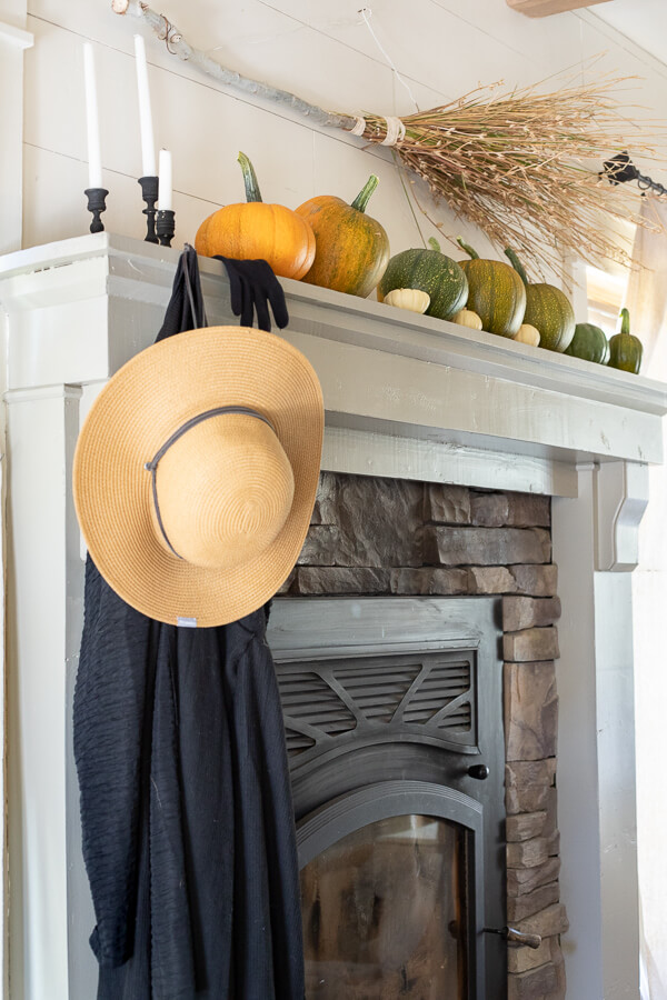 A very fun and stylish witch inspired Halloween mantel. Find a place to park your broom, hang your cloak and riding gloves and sit down and take a spell!