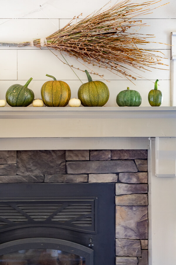 A witches broom, some baby pumpkins, and so much more in this very witchy Halloween mantel!